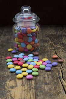 Smarties and candy jar on wood - LVF002982