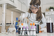 Girl playing science experiments at home - DERF000029