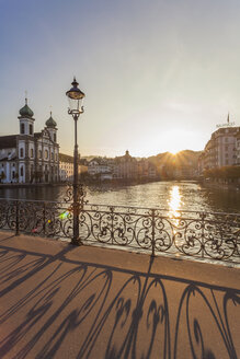 Switzerland, Canton of Lucerne, Lucerne, Old town, Reuss river, Jesuit church at sunset - WDF002948