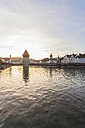 Switzerland, Canton of Lucerne, Lucerne, Old town, Reuss river, Chapel bridge and water tower at sunset - WDF002969