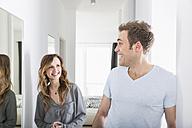 Couple meeting in corridor - PDF000868