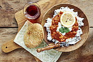 Seitan Tikka Masala on rice with soy yogurt and served with paratha breads and tea - HAWF000708