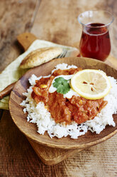 Seitan Tikka Masala on rice with soy yogurt and served with paratha breads and tea - HAWF000709