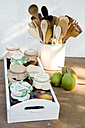 Wooden tray with preserving jars of pear chutneys - GIS000048
