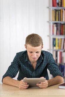 Teenage boy using digital tablet - DRF001476