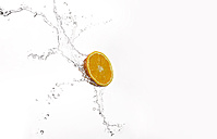 Orange and splash of water - KSWF001430