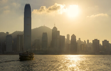 China, Hong Kong skyline from the sea at sunset - GEMF000106