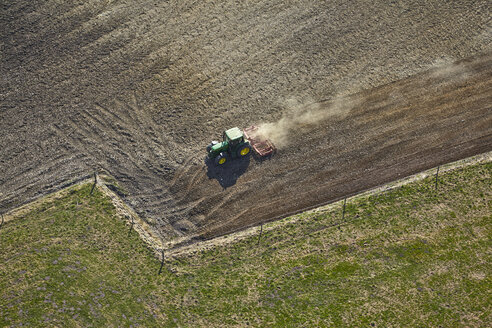 Germany, Bavaria, Aerial view of tractor on field - KDF000695