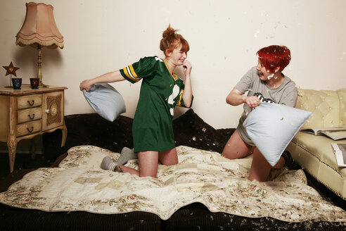 Pillow fight between two female friends at home - VEF000051