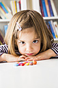Portrait of little girl with chocolate buttons - LVF003034