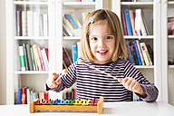 Portrait of happy little girl playing xylophones - LVF003040