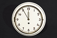 Old wall clock showing five to twelve - WEF000331