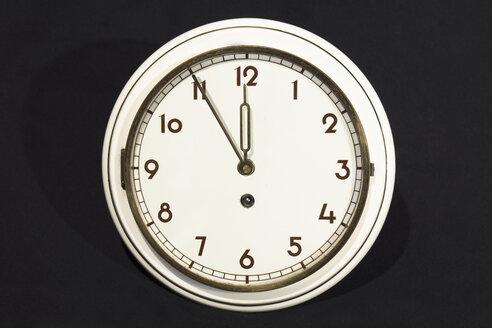 Old wall clock showing five to twelve - WEF000331