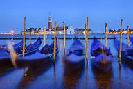 Italy, Venice, San Giorgio Maggiore with gondolas at night - RUEF001520