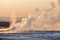 USA, Wyoming, Yellowstone National Park, steam rises in the Lower Geyser Basin at sunset - RUEF001580