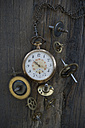 Old pocket watch and cogwheels on dark wood - CRF002647