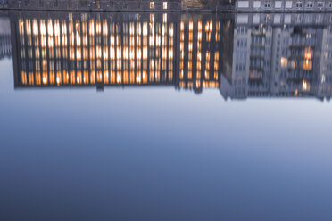Germany, Berlin, water reflections of lighted office building - ZMF000374