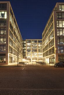 Germany, Berlin, lighted modern office buildings at development area - ZMF000377