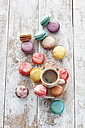 Cup of coffee and macarons on wood - CSF024887