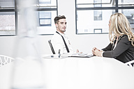 Businessman and businesswoman having an office meeting - ZEF004520