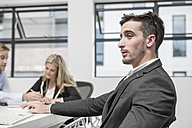 Businessman in meeting room thinking - ZEF004532