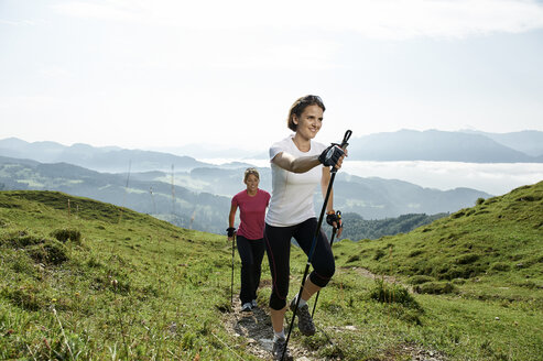 Austria, Two women Nordic walking at Kranzhorn - MAOF000067