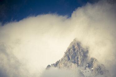 Austria, Salzburg State, Maria Alm, mountain in fog - NNF000189