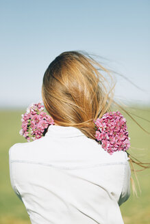 Rear view of woman with flowers outdoors - JPF000026