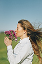 Woman with flowers outdoors - JPF000028