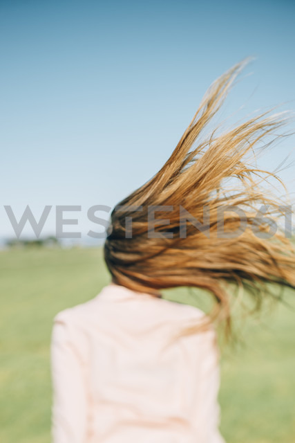 Wind moving long hair of a woman - JPF000031
