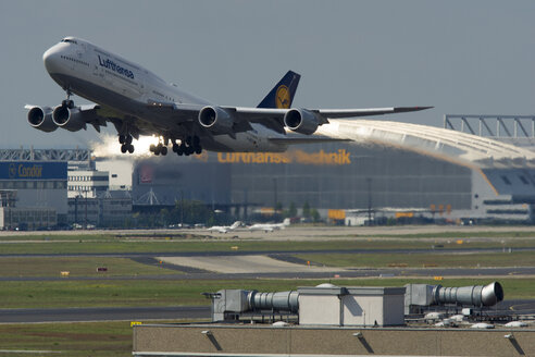 Germany, Frankfurt, Lufthansa Boeing 747 starting in front of maintenance hangar - JWA000265