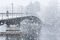 Germany, Baden-Wuerttemberg, Constance, Snowfall, Cycle bridge over Lake Rhine - KEBF000049