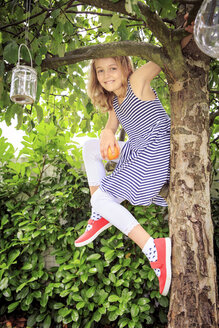 Germany, Girl in backyard climbing in tree - VTF000405