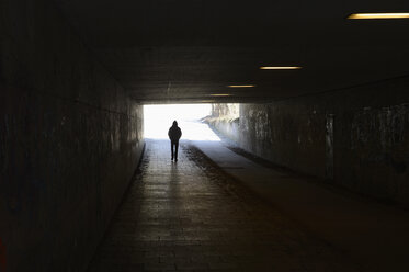 Person walking in tunnel - CRF002655