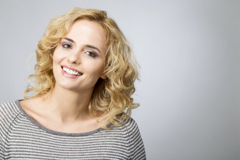 Portrait of smiling blond woman - MAEF009921