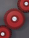 Red cogwheels in front of grey background, 3D Rendering - UWF000407