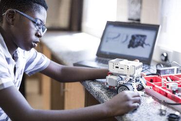 Schoolboy with laptop in robotics class - ZEF006087