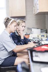 Two schoolgirls with laptop in robotics class - ZEF006105