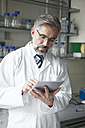 Scientist using digital tablet in laboratory - RBF002542
