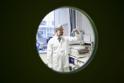 Scientist working behind door - RBF002547