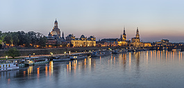 Germany, Dresden, lighted Old city in the evening with Elbe River in the foreground - PVC000306