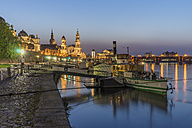 Germany, Dresden, lighted Old city in the evening with moored steam boat on Elbe River in the foreground - PVC000309