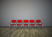 Row of five red chairs in front of a grey wall, 3D Rendering - ALF000431