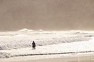Portugal, Algarve, Sagres, Mareta Beach, woman in the ocean - MRF001551