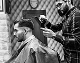Hairdresser and client in a barbershop - MGOF000135