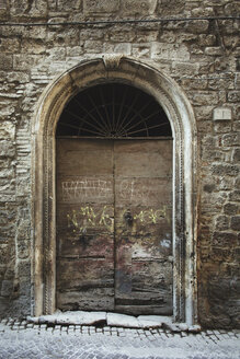 Italy, Ascoli Piceno, graffiti on old wooden entrance door - LSF000002