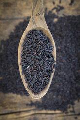Black organic basmati rice on spoon - LVF003071