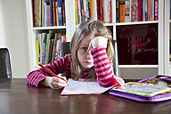 Frustrated girl doing homework - SARF001563