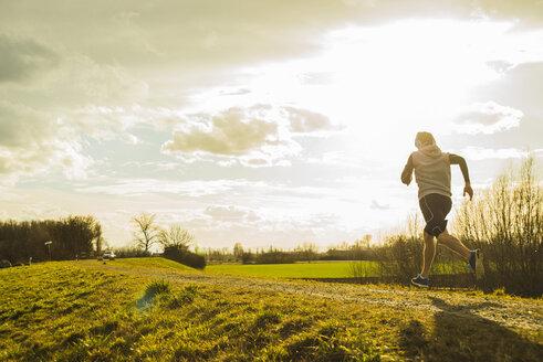 Germany, Mannheim, young man jogging - UUF003625