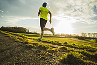 Germany, Mannheim, young man jogging - UUF003654